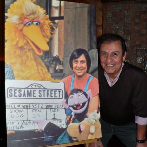Emilio Delgado poses next to his character Luis photo that marked Sesame Streets 1000th episode Photo dates Jan 26 1977 and January 14 2008