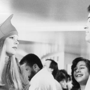 Still of Dan Aykroyd and Kim Basinger in My Stepmother Is an Alien 1988