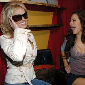 Pamela Anderson and Brittany Murphy at event of Total Request Live 1999