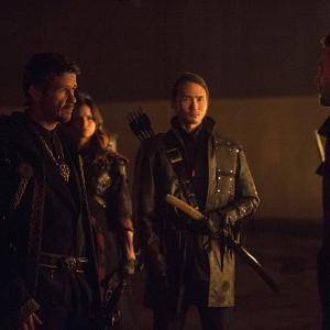 Still of Katrina Law, Karl Yune, Stephen Amell and Matt Nable in Strele (2012)