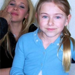Madison Meyer and Juno Temple having their makeup retouched
