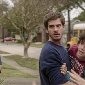 Still of Michael Shannon, Andrew Garfield and Noah Lomax in 99 Homes (2014)