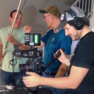 Evan Farber, R. Christian Anderson (director) and Clayton Moore (cinematographer) on the set of