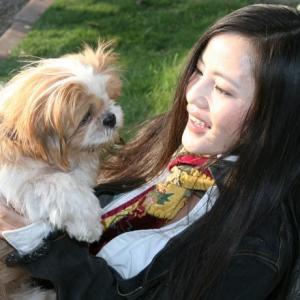 actress Nina Xining Zuo with her shihTzu puppy
