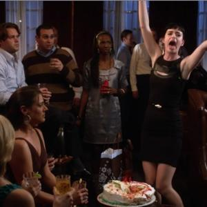 Mark Sinacori on Don't Trust The B- In Apartment 23 as a Birthday Party Guest to the left of Krysten Ritter in a brown striped sweater in the episode