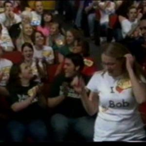 Mark Sinacori Paging at an episode of The Price Is Right that aired in early April 2007 (CBS, 2007)