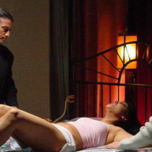 Thug  1  Noel Olken left tortures Iona Janina Gavankar as Alex Lance Mulvaney looks on in Cup Of My Blood