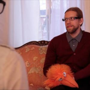 Still of Corey Tomicic as Mr. Rogers and Mr. Squawky in episode