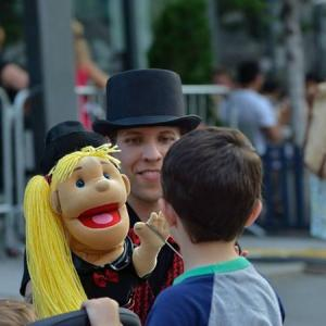 Still of Corey Tomicic and Millie at Jazz Fest 2013