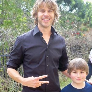 Eric Christian Olsen with Stone Eisenmann on set filming NCIS LA