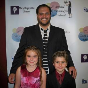 At the premiere of The Boy who became king is HannaH Eisenmann and Stone Eisenmann with the writer of the film.