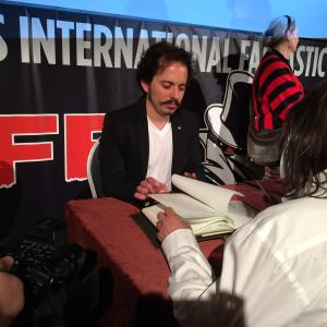 Isaac Ezban signing autographs after the screening of THE INCIDENT at BIFFF (Brussels International Fantastic Film Festival), April 2015