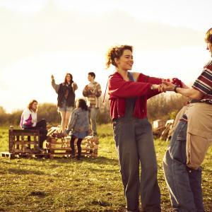 Still of Elliott Tittensor and Emilia Clarke in Spike Island 2012