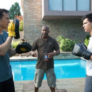 Still of Jason Isaacs John Singleton and Taylor Lautner in Abduction 2011
