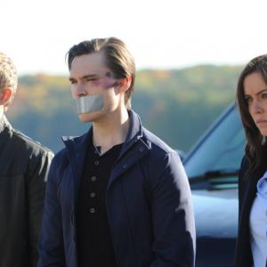 Still of Shawn Ashmore Jessica Stroup and Sam Underwood in The Following 2013