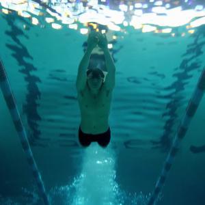 Joel Courtney swimming in Season 1 Episode 1 of The Messengers