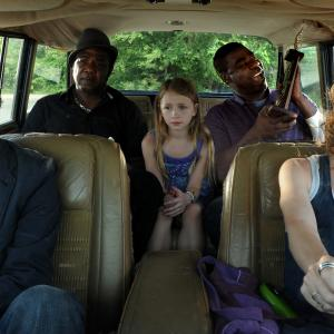 Still of Jesse Eisenberg Melissa Leo Tracy Morgan Isiah Whitlock Jr and Emma Rayne Lyle in Why Stop Now? 2012