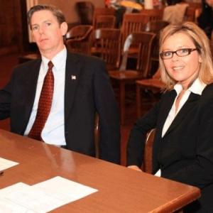 Still image of Jodie Shultz and T Arnold as District Attorney and Assistant District Attorney on the set of The Alibi