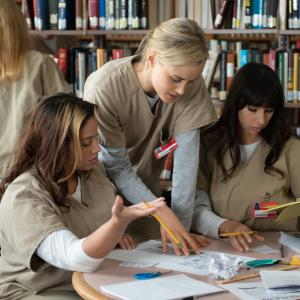 Still of Taylor Schilling, Jackie Cruz and Dascha Polanco in Orange Is the New Black (2013)