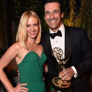 January Jones and Jon Hamm at event of The 67th Primetime Emmy Awards (2015)