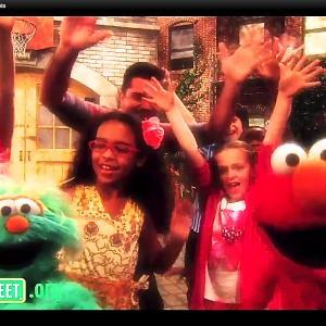 Meg Donnelly with Rosita Elmo and Juanes  Sesame Street Episode 42