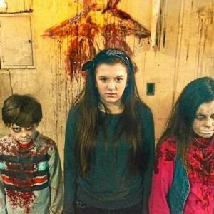 Joe Cipriano (left) as Christopher, Niki Cipriano (center), Victoria Lurz (right) in The Oakland Press News article on the horror film, Dead Quiet