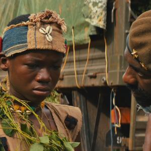 Still of Idris Elba and Abraham Attah in Beasts of No Nation (2015)