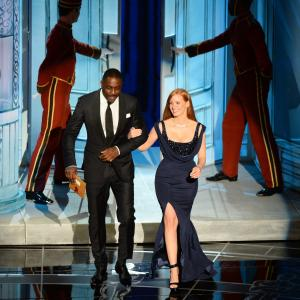 Idris Elba and Jessica Chastain at event of The Oscars (2015)