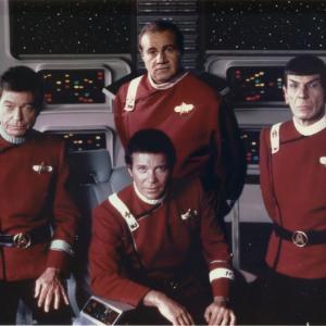 Larry A Thompson posing aboard the Starship Enterprise with Star Trek cast