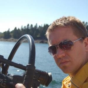 Jeremy filming on the Tall ships in the Bay of Fundy