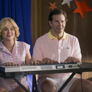 Still of Bradley Cooper and Amy Poehler in Wet Hot American Summer: First Day of Camp (2015)