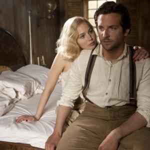 Still of Bradley Cooper and Jennifer Lawrence in Serena (2014)