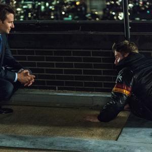 Still of Bradley Cooper and Jake McDorman in Limitless (2015)