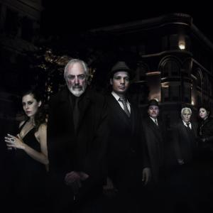 Official Cast Photo From L to R: John C Smith as the Apocalypse Man, Derek Mobraaten as Tom Smith, Julian Grant as Edward Hull, Bahia Garrigan as Christina Novello, Jerry Lacy as Dr. Mabuse, Nathan Wilson as Inspector Carl Lohemann, David Graham as City General Oscar Lang, Linden Chiles as Inspector Norbert Von Wenk, Vivian Brasch as Lady Levana, Kathryn Leigh Scott as Madame Von Harbau, Lara Parker as Madame Carrozza, and Annie Waterman as Madame Hecate