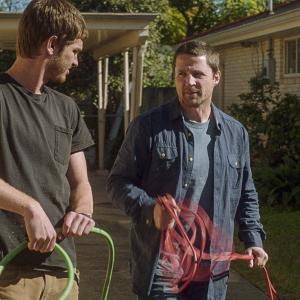 Still of Tim Guinee and Andrew Garfield in 99 Homes (2014)
