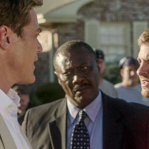 Still of Michael Shannon and Andrew Garfield in 99 Homes (2014)