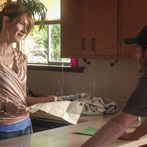 Still of Laura Dern and Andrew Garfield in 99 Homes (2014)
