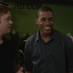 From left to right: James Poole (Paddy), Lance Lemon (Chuck). 'Chuck' facilitates an initial meeting in the flower shop scene.
