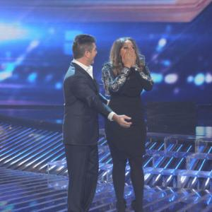 Still of Simon Cowell and Melanie Amaro in The X Factor (2011)