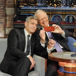 George Clooney and David Letterman at event of Late Show with David Letterman (1993)