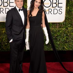 George Clooney and Amal Clooney at event of 72nd Golden Globe Awards (2015)