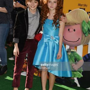 Actors Noah Schnapp (L) and Francesca Capaldi attend the premiere of 20th Century Fox's 'The Peanuts Movie' at the Regency Village Theatre in Westwood, California.