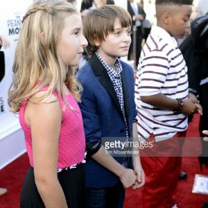 Hadley Belle Miller, Noah Schnapp, and Mar Mar attend the premiere of 20th Century Fox's 'The Peanuts Movie' at Pier 39 in San Francisco, California.
