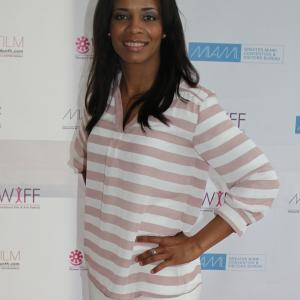Dreka Shevon at the Women's International Film Festival in Miami where not only did her film, the Companion walked away with an award, by the hot young writer/producer also shared her wisdom while speaking on the Domestic Violence Panel